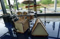 Triangle and square kick drums!  Awesome, I wonder how it sounds. Replacement heads must be hard to come by.  http://fordrummersbydrummers.com/