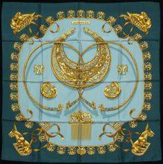 """Hermes paris made in france, carré en soie imprimée titré """" les cavaliers d'or"""", signé rybal, taches /"""