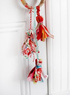 Pretty Scrap Fabric Tassels Tutorial. Just ribbon and fabric scraps......