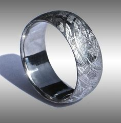 Style #001: Arizona Skies Seamless™, domed Gibeon Meteorite Ring with beautiful Widmanstatten pattern. This elegant ring is crafted from a solid billet of Gibeon meteorite. Shown in a size 11.25, and 8.5 mm width. Price as shown: ONLY $795.00!