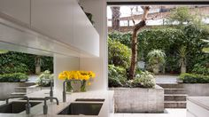 William Tozer Associates has overhauled a Victorian house in London, introducing a white, modern living area that faces a neighbouring brutalist estate