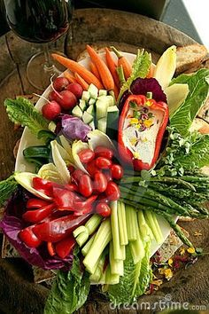 Vegetable platter w/ tomatoes, asparagus, celery sticks, red peppers . love the dip served in the red bell pepper (Cheese Table Veggies) Veggie Platters, Party Platters, Veggie Tray, Cheese Platters, Vegetable Salad, Vegetable Tray Display, Vegetable Trays, Vegetable Sticks, Serving Platters