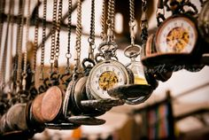 hanging old pocket watches?? so cute.
