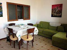 Ferienwohnung: Casa dei Fiori in Praiano - Gemütliches Wohn-/Esszimmer mit Durchreiche zur Küche. www.amalfi-ferien.de