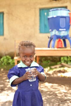 LifeStraw Community filter provides safe drinking water to school children including 6 year old Rebecca in Bungoma, Kenya.