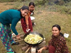 Cooking up a feast for 50 in the middle of a field. Nepali women are amazing!!!!!