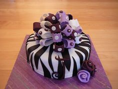 A purple version of a zebra cake so popular for the teenagers! This marble cake and chocolate ganache was all covered with fondant. I love making big bows!
