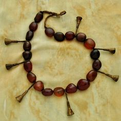 India | Antique Konyak Naga Tribal Carnelian and Brass Trumpet necklace.