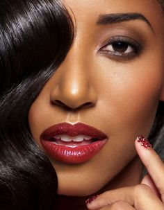 From the curls over one eye, the perfect accent of color for the lips and even nails revealed you can go on and on