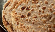 Wholemeal griddle bread, otherwise known as paratha. Madhur Jaffrey& delicious Indian flatbread recipe is simple and reliable. It will transform your Indian cooking. Madhur Jaffrey, Roti Recipe, Masala Curry, Flatbread Recipes, Chicken Tikka Masala, Griddles, Curry Recipes, Tray Bakes, Indian Food Recipes