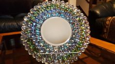 I created this beautifully decorated plate using gems and a mirror from the Dollar Tree. This is a budget-friendly craft idea that's was to create! Dollar Tree Mirrors, Dollar Tree Vases, Dollar Tree Crafts, Dollar Store Mirror, Easy Diy Crafts, Diy Arts And Crafts, Craft Stick Crafts, Charger Plate Crafts, Mirror Plates