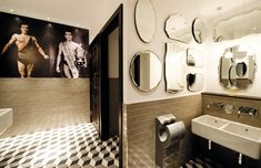 restaurant bathroom interior.  Pictures are a little odd, but love the use of mirrors.