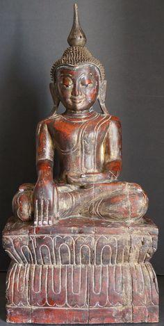 http://goldentriangleantiques.com/wp-content/uploads/2013/07/Burmese-Pagan-Teak-Wood-Buddha-Statue-855.jpg