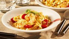 Saftige gebratene Garnelen, frische Tomaten und würziger Knoblauch mit Bandnudeln in einer cremigen Kräuter-Rahm Sauce – einfach lecker!