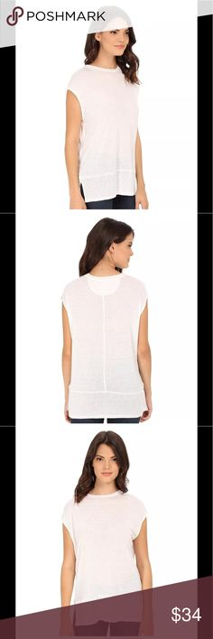 """NEW FREE PEOPLE Muscle tee tank top slub tunic New with tags We the Free Size xs Flaunt your tough-girl style in a relaxed-fit muscle tee finished with raw-edge piecing and side vents. - Crew neck - Sleeveless - Approx. 26.5"""" length /21"""" wide 70% rayon, 30% linen Free People Tops Tunics"""