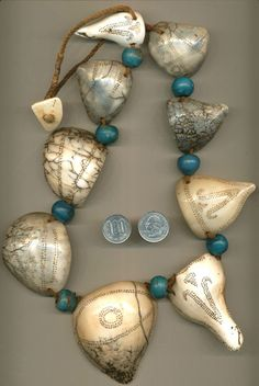 Antique Naga shell pendants and trade beads.