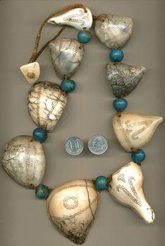 Antique Naga shell pendants and trade beads.