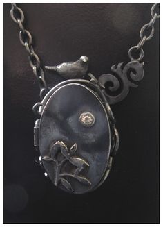 I Love Handmade: Oxidised Silver Oval Dove Locket by Jesa @ Two Red Trees