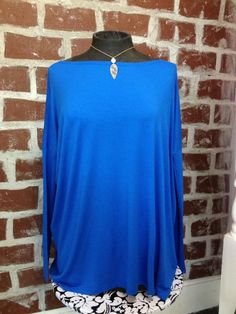 Long sleeve royal blue Piko top! Made of bamboo and spandex...unbelievably soft! $42! Available here: http://8thstreetboutique.com/products/long-sleeve-piko-tee