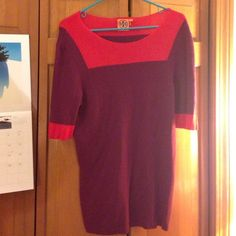 Tory Burch short sleeve sweater Washed but never worn. Beautiful short sleeve TB purple and red sweater. Says size XL but listing as an L as it is closer to that fit. Measures approx 17 in wide, 28 in shoulder to hem. Tory Burch Sweaters