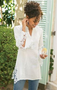 "This lightweight linen tunic with crocheted accents along its split long sleeves and high-low hem makes for a pretty summer piece. With neat mandarin collar, princess seaming and etched shell buttons on the center front placket. Misses 30"" long. Meadowsweet Linen Tunic #29985"