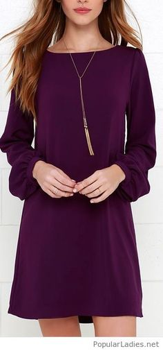 Simple purple dress with a long necklace
