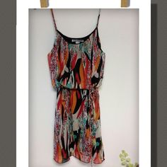 Dress Cute dress with an abstract pattern design,with an inner liner.. spaghetti shoulder straps and a tie belt.  100%Polyester....Length is approximently 26in.  NWOT Poetry Dresses