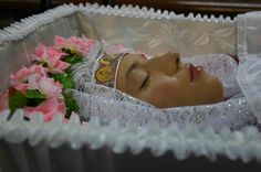 Russian woman in her open casket during her funeral.
