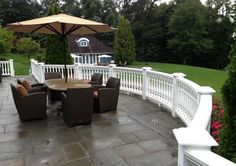 INTEX: Nautilus Milled Railing System installed on a stone patio