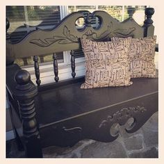 Bed headboard bench and burlap key pillows on the porch.