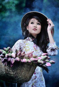 Stereotypical but beautiful nonetheless. Beautiful girl and beautiful ao dai.