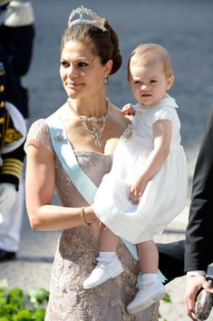 Crown Princess Victoria of Sweden with her daughter Princess Estelle of Sweden  attend the wedding of her sister Princess Madeleine and Christopher O'Neill at The Royal Palace on 8 June 2013 in Stockholm