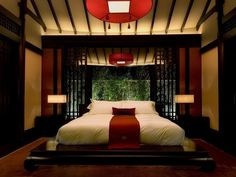 Check out the lighting and ceiling design. Also, the bed sheets with a simple red runner is nice.