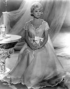"Doris Day  in ""The Thrill of it All.""     I just love her....and love her dresses......her hair style"