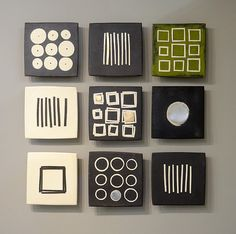 Black and White and Green by Lori Katz. Slab built stoneware with slip, underglaze, stoneware inlay, glaze, oil paint, cold wax, metal leaf backed on wood and wired to hang simply on a picture hook . The grouping comes with a hanging template that makes installation a piece of cake! Each tile is created an hung individually. Dimensions refer to grouping, as shown. Available at www.artfulhome.com