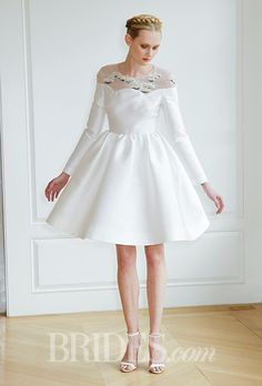Brides.com: . Knee-length A-line wedding dress with long sleeves and an illusion embroidered high neckline, Honor
