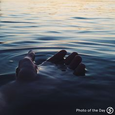 Photo of the Day by Story Sasseen #swblog hand in water at sunset