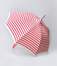 Some stripes for the sprinkle? Antique old world charm and marvelous modernism create a sensationally striking umbrella that doubles perfectly as a parasol. A dainty pink and cream striped eight panel spoke umbrella with a pagoda roof style tip is outfitt