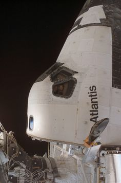 February 15, 2008 – Astronauts Alan Pointdexter and Steve Frick look out the starboard window of the Space Shuttle Atlantis while it's docked to the International Space Station.