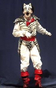 Kind of weird Zebra stripes, but interesting merging of colors for hands and sleeves, and coordination of cape tie, belt, and boots.
