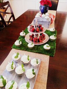 Kentucky Derby bridal shower theme. Mint Julep cupcakes with chocolate dipped strawberry's.