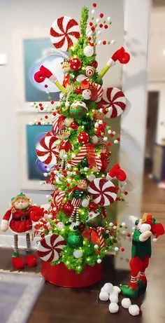 Playful elves and candy cane lollipops capture the fun of the season Grinch Christmas Decorations, Grinch Christmas Party, Cool Christmas Trees, Noel Christmas, Christmas Projects, Christmas Themes, Christmas Wreaths, Christmas Tree Inspiration, Candy Cane