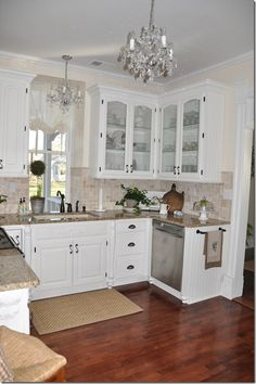Kitchen faces north. Des used Pratt and Lamberts antique white for the walls.