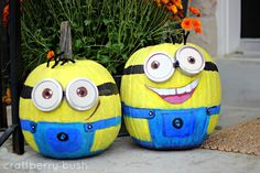 minion pumpkins.  OMG too cute.  The goggles are made with baby food lids.