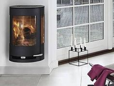 The modern HWAM 3110 helps create a warm and cozy atmosphere in your house. This elliptical hanging stove showcases design originated in pure Scandinavian lines Read Modern Log Burners, Modern Stoves, Stove Heater, Pellet Stove, Wood Burner, Black Wood, Wall Mount, Contemporary