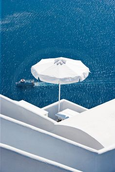 The White Umbrella in Santorini, Greece.  Go to www.YourTravelVideos.com or just click on photo for home videos and much more on sites like this.