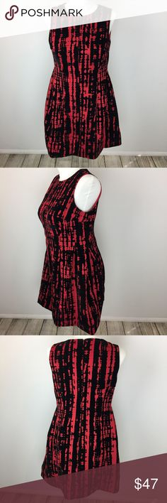 Calvin Klein Plus Size Fit & Flare Dress -NWOT 16W NWOT Calvin Klein sleeveless red dress with a-line Fit and Flare shape, featuring black velvet abstract pattern, hidden back zipper and fully lined inside. This if for a NWOT Size 16W. We also have a NWT in size 14W listed in our closet. R1 Calvin Klein Dresses Midi