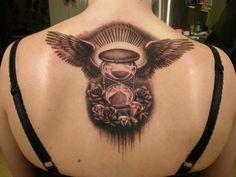 Hourglass on back - 50 Awesome Back Tattoo Ideas