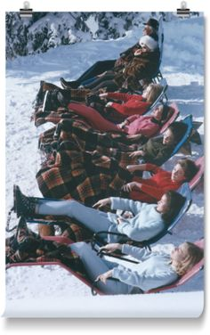 Young women enjoy a relaxing sunbathe in snowy Gstaad.