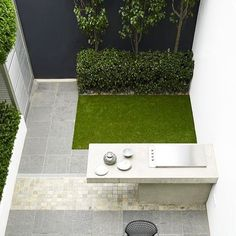 Artificial grass is perfect for small areas. It looks totally low maintenance yet lovely.